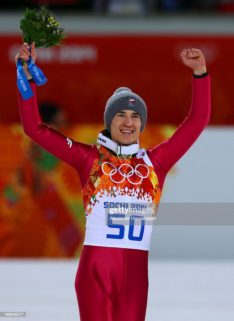 Gold medalist Kamil Stoch of Poland celebrates on the podium during the flower ceremony after the Men's Large Hill Individual Final Round on day 8 of the Sochi 2014 Winter Olympics at the RusSki Gorki Ski Jumping Center on February 15, 2014 in Sochi, Russia.