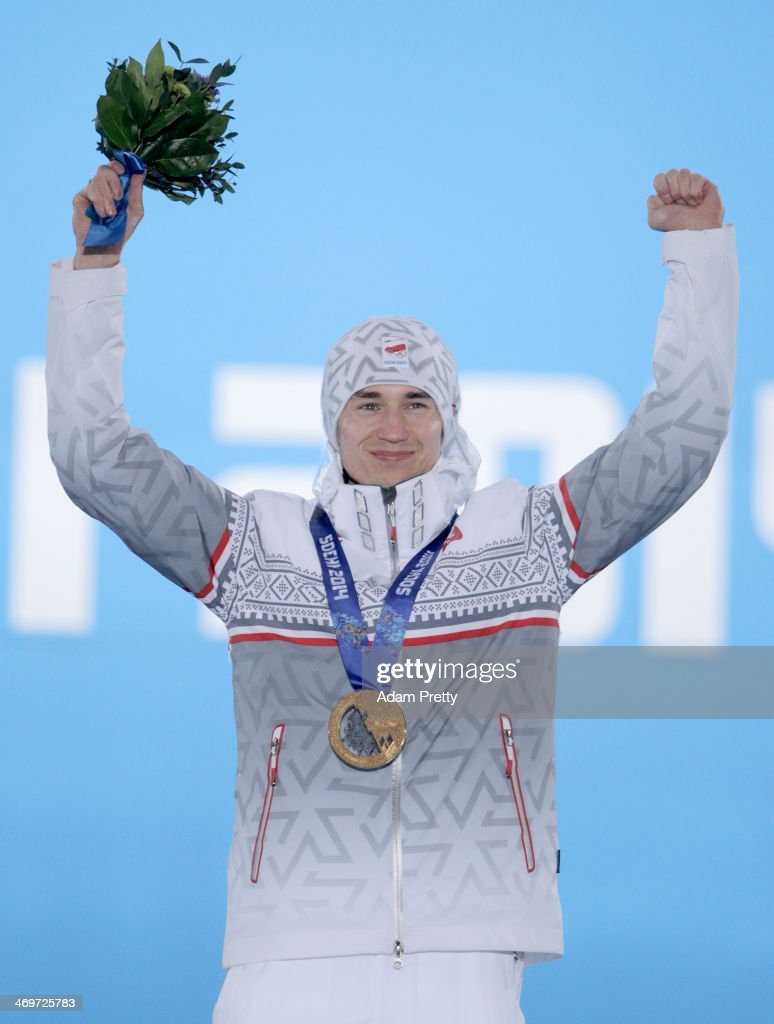 Gold medalist <a gi-track='captionPersonalityLinkClicked' href=/galleries/search?phrase=Kamil+Stoch&family=editorial&specificpeople=820513 ng-click='$event.stopPropagation()'>Kamil Stoch</a> of Poland celebrates on the podium during the medal ceremony for the Men's Large Hill Individual on day 9 of the Sochi 2014 Winter Olympics at Medals Plaza on February 16, 2014 in Sochi, Russia.