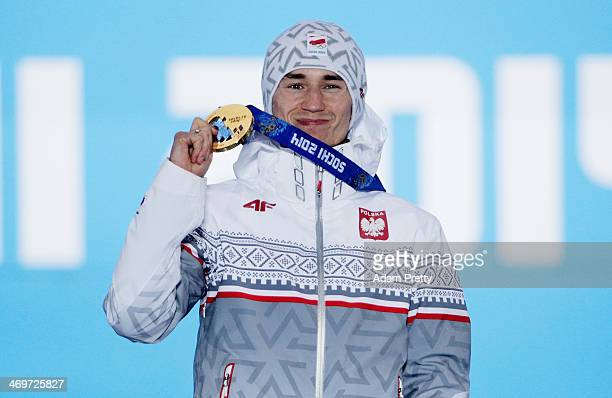 Gold medalist Kamil Stoch of Poland celebrates on the podium during the medal ceremony for the Men's Large Hill Individual on day 9 of the Sochi 2014...