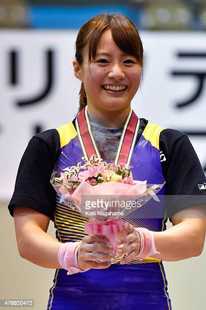 Gold Medalist Kanae Yagi celebrates on the podium after winning in women's 53kg group during the All Japan Weight Lifting Championships 2015 at the...