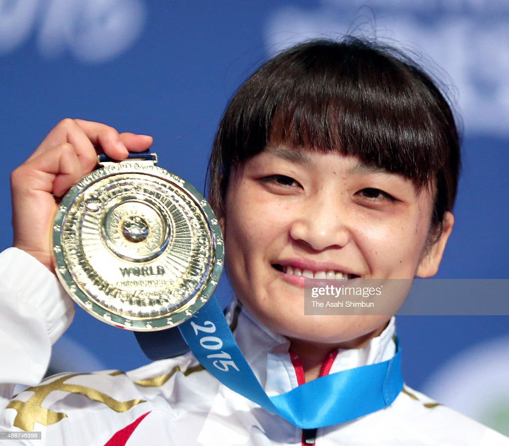 Gold medalist <a gi-track='captionPersonalityLinkClicked' href=/galleries/search?phrase=Kaori+Icho&family=editorial&specificpeople=2374687 ng-click='$event.stopPropagation()'>Kaori Icho</a> of Japan celebrates on the podium at the medal ceremony for the Women's Freestyle -58kg during day four of the World Wrestling Championships at the Orleans Arena on September 10, 2015 in Las Vegas, Nevada.