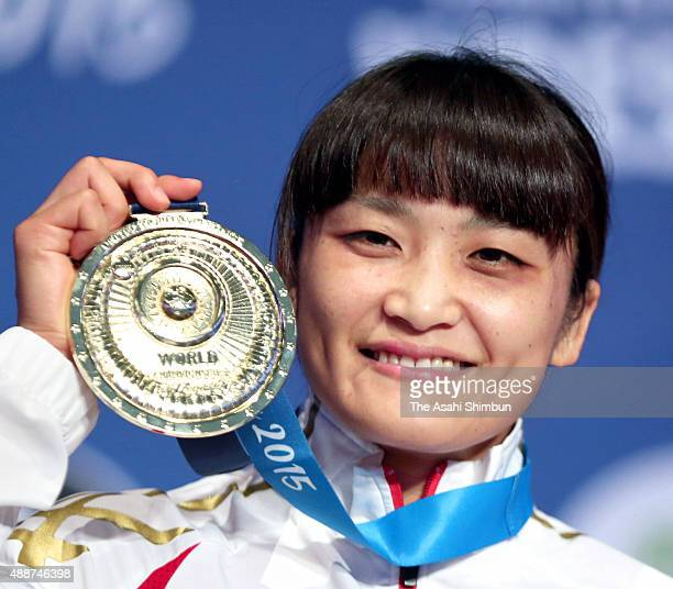 Gold medalist Kaori Icho of Japan celebrates on the podium at the medal ceremony for the Women's Freestyle 58kg during day four of the World...