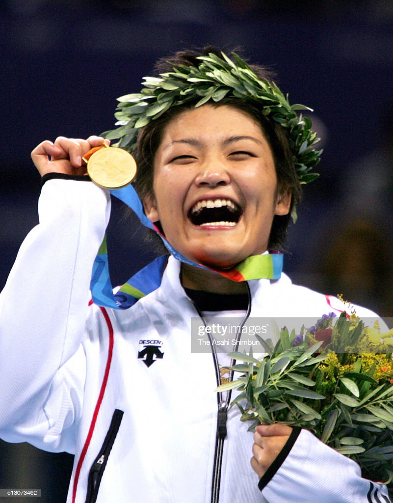 Gold medalist <a gi-track='captionPersonalityLinkClicked' href=/galleries/search?phrase=Kaori+Icho&family=editorial&specificpeople=2374687 ng-click='$event.stopPropagation()'>Kaori Icho</a> of Japan celebrates on the podium at the medal ceremony for the Wrestling Women's -63kg final at the Ano Liossia Olympic Hall during day ten of the Athens Olympics on August 23, 2004 in Athens, Greece.