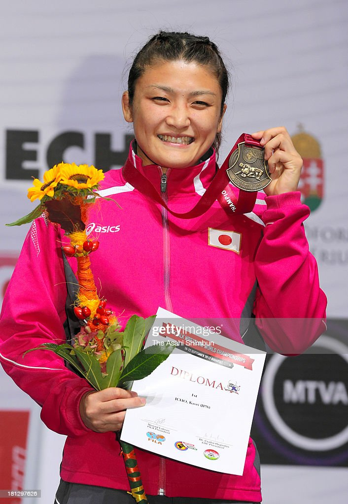 Gold medalist <a gi-track='captionPersonalityLinkClicked' href=/galleries/search?phrase=Kaori+Icho&family=editorial&specificpeople=2374687 ng-click='$event.stopPropagation()'>Kaori Icho</a> poses for photographs on the podium after winning the Women's 63kg Freestyle day four of the FILA Wrestling World Championships at Papp Laszlo Budapest Sportarena on September 19, 2013 in Budapest, Hungary.