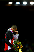 Gold medalist Kariem Hussein of Switzerland cries on the podium during the medal ceremony for the Men's 400 Hurdles metres final during day four of...