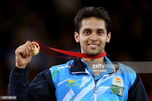Gold medalist Kashyap Parupalli of India poses in the medal ceremony for the Men's Singles Gold Medal Match at Emirates Arena during day eleven of...