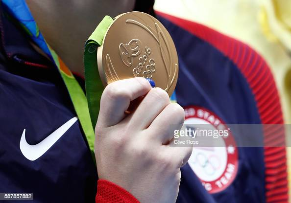 Gold medalist Katie Ledecky of the United States poses during the medal ceremony for the Women's 200m Freestyle Final on Day 4 of the Rio 2016...