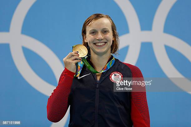 Gold medalist Katie Ledecky of the United States poses on the podium during the medal ceremony for the Women's 400m Freestyle Final on Day 2 of the...