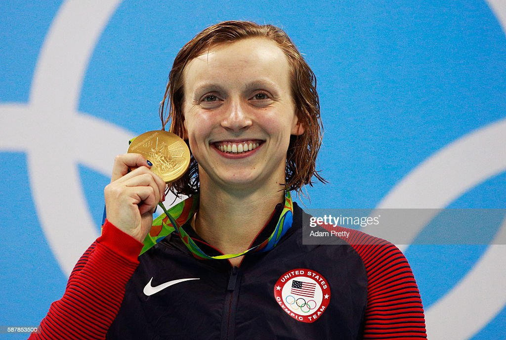 Gold medalist Katie Ledecky of the United States poses on the podium during the medal ceremony for the Women's 200m Freestyle Final on Day 4 of the...