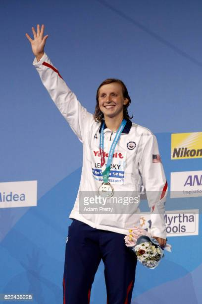 Gold medalist Katie Ledecky of the United States poses with the medal won during the Women's 1500m Freestyle on day twelve of the Budapest 2017 FINA...