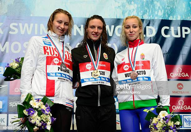 Gold medalist Katinka Hosszu of Hungary silver medalist Veronika Popova of Russia and bronze medalist Evelyn Verraszto of Hungary pose on the podium...