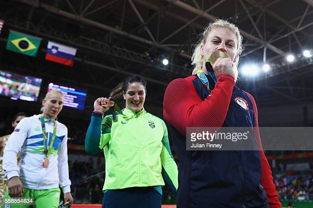 Gold medalist Kayla Harrison of the United States celebrates after defeating Audrey Tcheumeo of France during the women's 78kg gold medal judo...