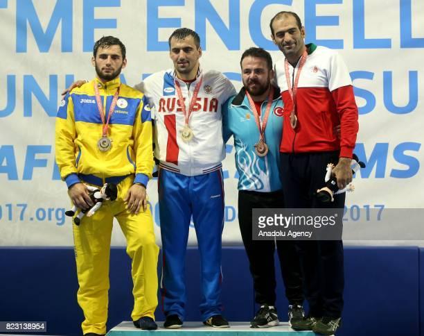 Gold Medalist Kazbek Khugaev of Russia silver medalist Anatolii Chervonenko of Ukraine bronze medalist ohsen Manouchehrtelouri of Iran and bronze...