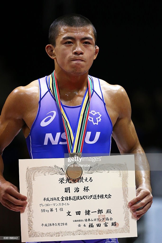 Gold medalist Kenichiro Fumita (blue) celebrates at the award ceremony for the Men's 59kg greco-roman style Fainal match All Japan Wrestling Championships at Yoyogi National Gymnasium on May 29, 2016 in Tokyo, Japan.