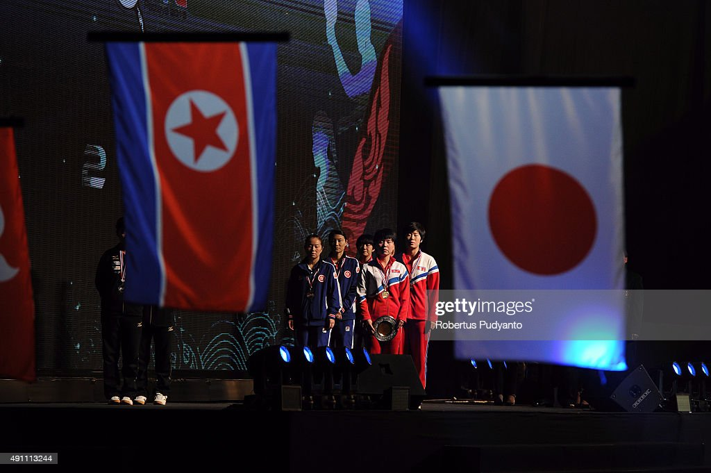 Gold medalist Kim Hye Song and Ri Mi Gyong of DPR Korea (R) and bronze medalist Jiang Huajun and Tie Yana of Hong Kong (L) celebrate on the podium during Women's doubles awarding ceremony of the 22nd 2015 ITTF Asian Table Tennis Championships at Pattaya Sports Indoor Stadium on October 3, 2015 in Pattaya, Thailand.