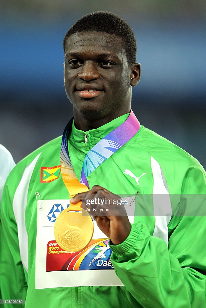 Gold medalist <a gi-track='captionPersonalityLinkClicked' href=/galleries/search?phrase=Kirani+James&family=editorial&specificpeople=5432961 ng-click='$event.stopPropagation()'>Kirani James</a> of Grenada celebrates on the podium with his medal for the men's 400 metres during day six of 13th IAAF World Athletics Championships at Daegu Stadium on September 1, 2011 in Daegu, South Korea.