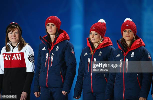 Gold medalist Kirsten Wall of Canada and bronze medalists Eve Muirhead Anna Sloan and Vicki Adams of Great Britain celebrate during the medal...