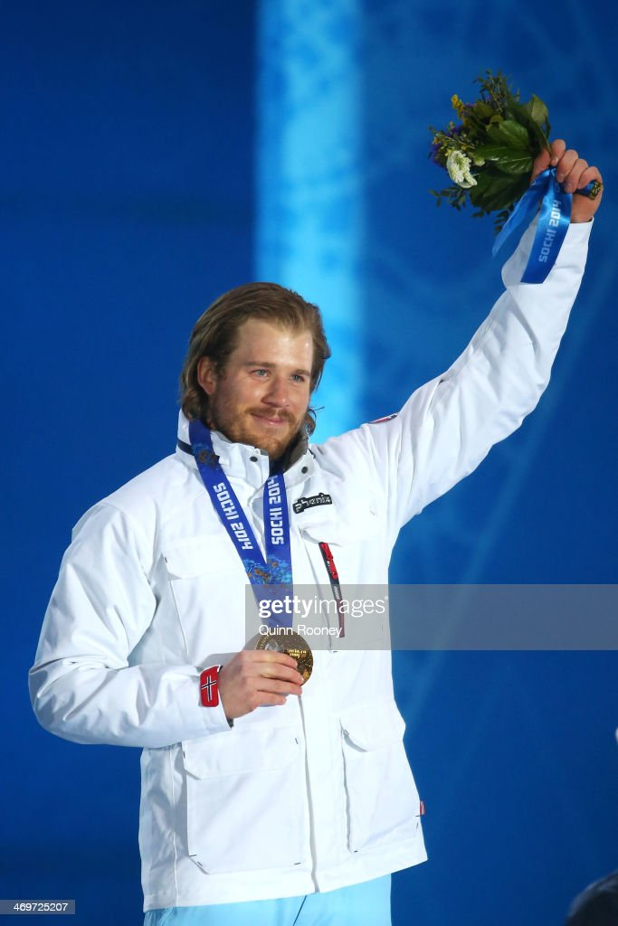Gold medalist <a gi-track='captionPersonalityLinkClicked' href=/galleries/search?phrase=Kjetil+Jansrud&family=editorial&specificpeople=816480 ng-click='$event.stopPropagation()'>Kjetil Jansrud</a> of Norway celebrates on the podium during the medal ceremony for the Men's Super-G Alpine Skiing on day 9 of the Sochi 2014 Winter Olympics at Medals Plaza on February 16, 2014 in Sochi, Russia.