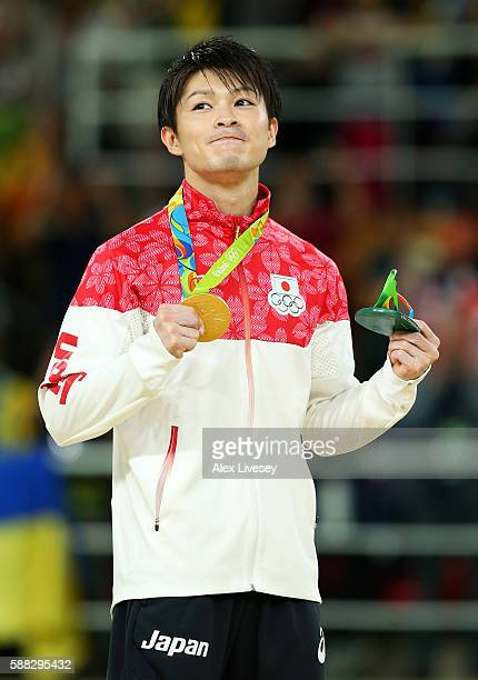 Gold medalist Kohei Uchimura of Japan celebrates on the podium at the medal ceremony for the Men's Individual AllAround on Day 5 of the Rio 2016...