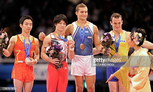 Gold medalist Kohei Uchimura of Japan silver medalist Zou Kai of China bronze medalists Alexander Shatilov of Israel and Diego Hypolito of Brazil...
