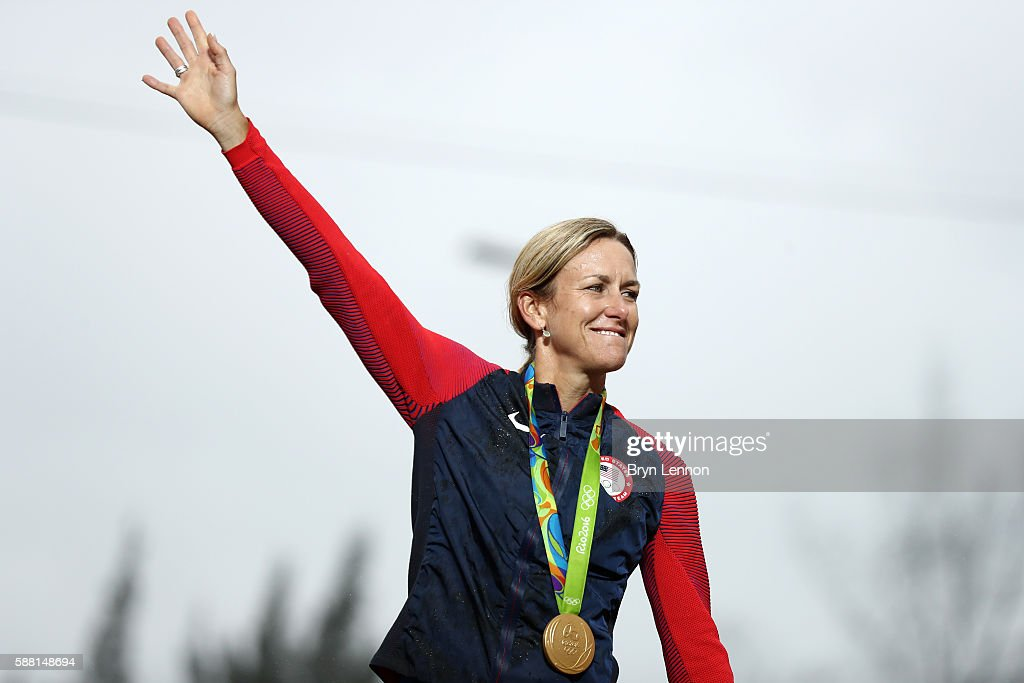 Gold medalist Kristin Armstrong of the United States waves on the podium at the medal ceremony for the Cycling Road Women's Individual Time Trial on...