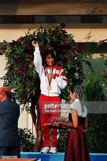 Gold medalist Kyoko Iwasaki of Japan celebrates on the podium at the medal ceremony for the Women's 200m Breaststroke during the Barcelona Summer...