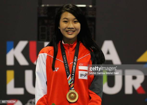 Gold medalist Lau Ywen of Singapore smiles after winning the final Mens's Epee Individual game during victory ceremony as part of the 2017 SEA Games...