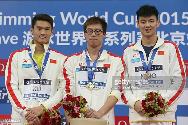 Gold medalist Li Zhuhao of ChinaSilver medalist Xu Jiayu of China and bronze medalist Ning Zetao of China pose during the medal ceremony for the...