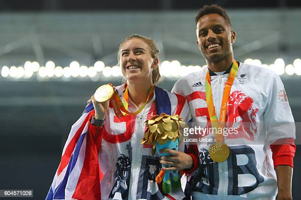 Gold medalist Libby Clegg of Great Britain and her guide Chris Clarke poses on the podium at the medal ceremony for women's 200m T11 during day 6 of...
