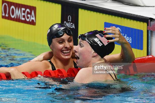 Gold medalist Lilly King of the United States celebrates with silver medalist Katie Meili of the United States during the Women's 100m Breaststroke...