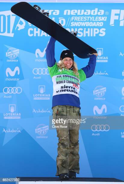 Gold Medalist Lindsey Jacobellis of the United States celebrates during the flower ceremony for the Women's Snowboard Cross on day five of the FIS...