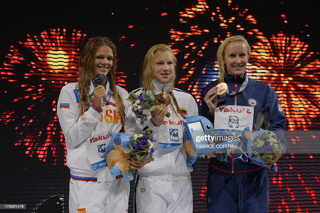 Gold medalist Lithuania's Ruta Meilutyte (C), silver medalist Russia's Yuliya Efimova (L) and bronze medalist US swimmer Jessica Hardy pose on the podium during the award ceremony of the women's 100-metre breaststroke swimming event in the FINA World Championships at Palau Sant Jordi in Barcelona on July 30, 2013.