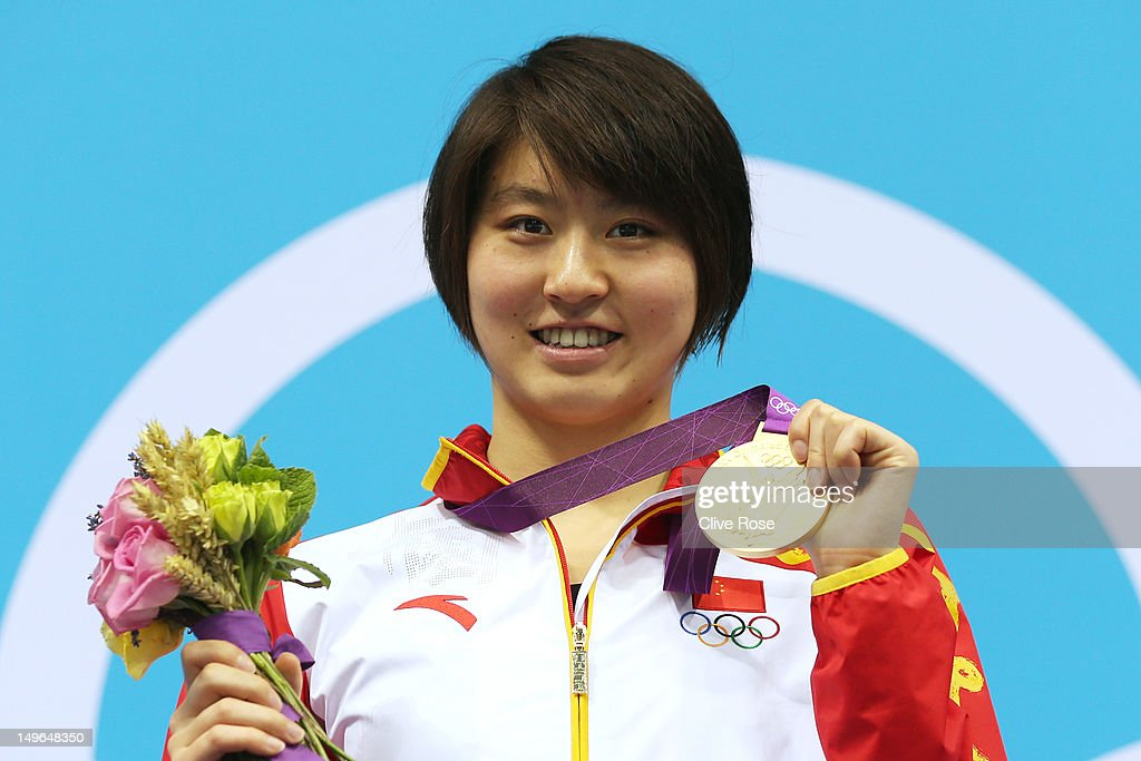 Gold medalist Liuyang Jiao of China celebrates with her medal during the medal ceremony for the Women's 200m Butterfly on Day 5 of the London 2012 Olympic Games at the Aquatics Centre on August 1, 2012 in London, England.