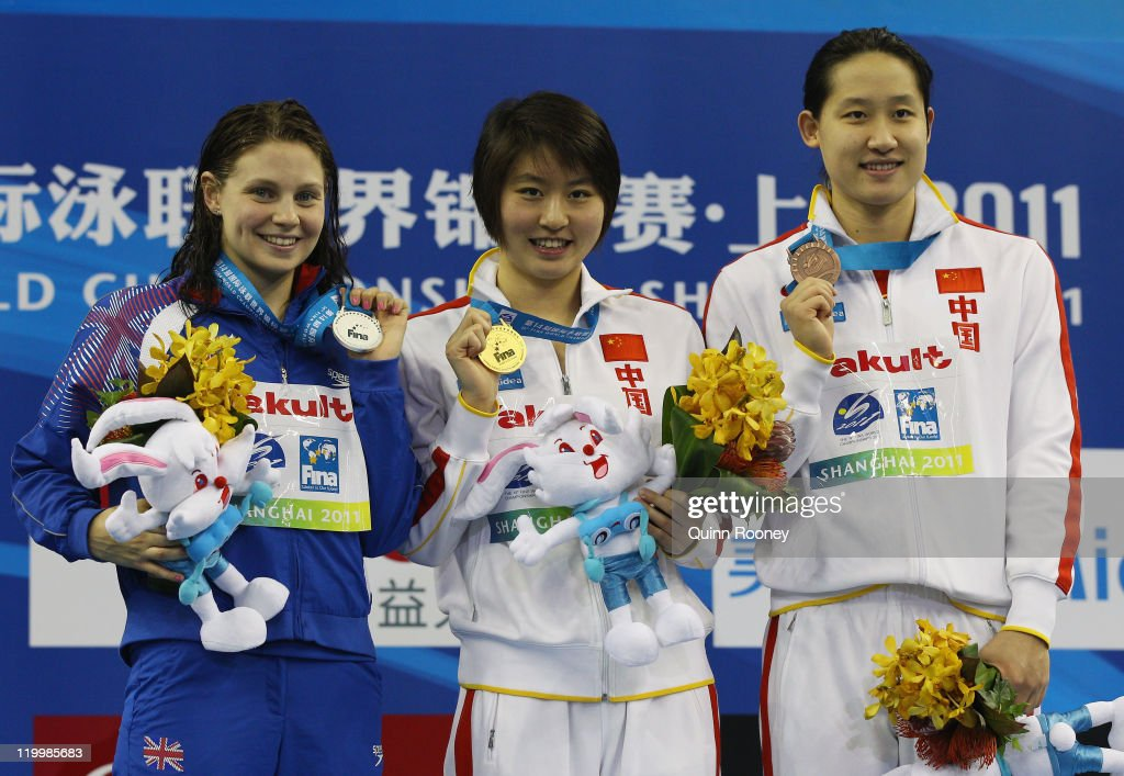 Gold medalist Liuyang Jiao (C) of China poses with silver medalist Ellen Gandy of Great Britain and bronze medalist Zige Liu of China after the Women's 200m Butterfly Final during Day Thirteen of the 14th FINA World Championships at the Oriental Sports Center on July 28, 2011 in Shanghai, China.