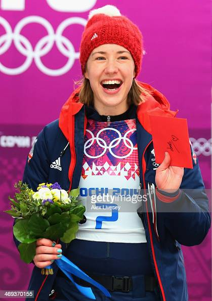 Gold medalist Lizzy Yarnold of Great Britain celebrates holding the valentine's card to present to her boyfirend and coach James Roche on the podium...