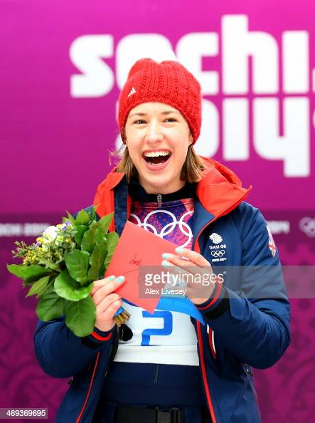 Gold medalist Lizzy Yarnold of Great Britain celebrates on the podium during the flower ceremony for the Women's Skelton on Day 7 of the Sochi 2014...