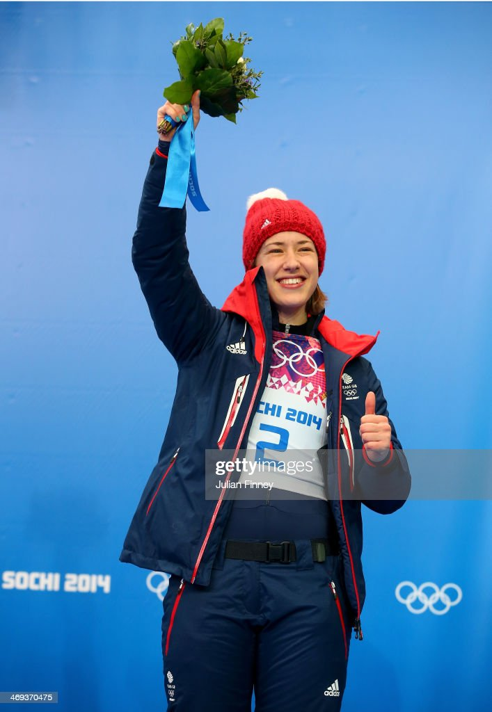 Gold medalist Lizzy Yarnold of Great Britain celebrates on the podium during the flower ceremony for the Women's Skelton on Day 7 of the Sochi 2014 Winter Olympics at Sliding Center Sanki on February 14, 2014 in Sochi, Russia.