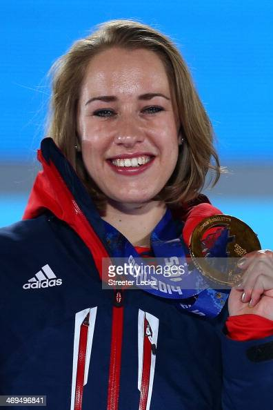 Gold medalist Lizzy Yarnold of Great Britain celebrates on the podium during the medal ceremony for the Women's Skelton on day 8 of the Sochi 2014...
