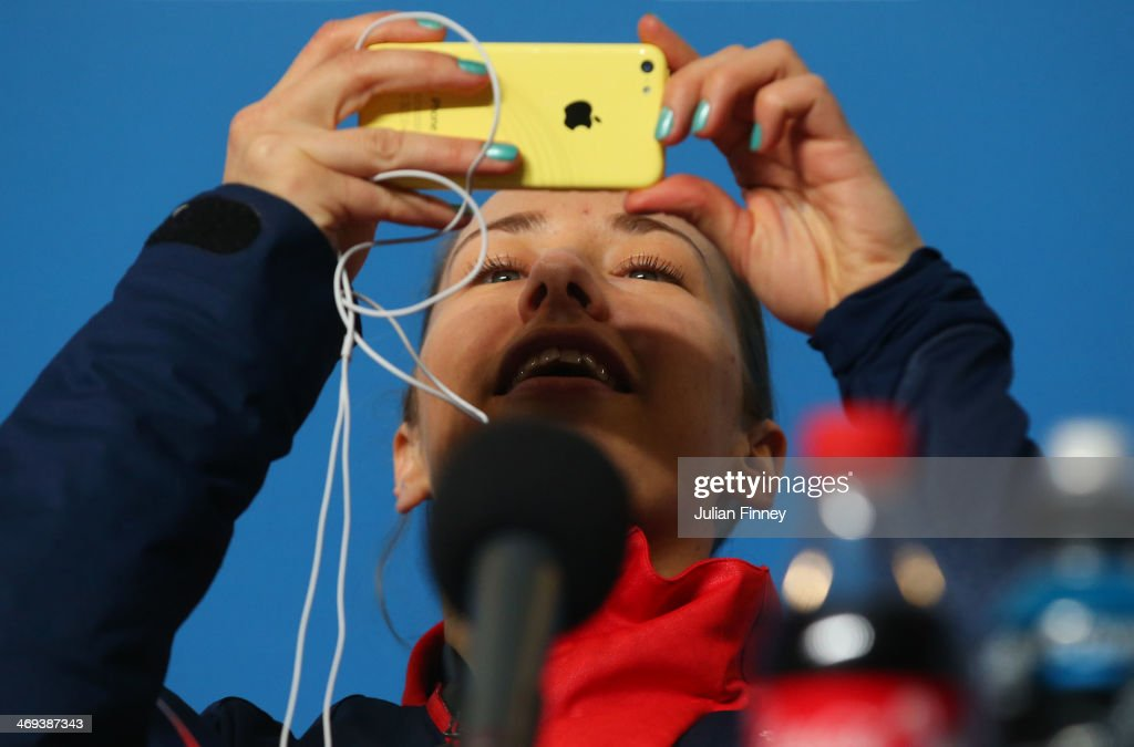 Gold medalist <a gi-track='captionPersonalityLinkClicked' href=/galleries/search?phrase=Lizzy+Yarnold&family=editorial&specificpeople=9514411 ng-click='$event.stopPropagation()'>Lizzy Yarnold</a> of Great Britain takes a photograph during a press conference after the Women's Skeleton on Day 7 of the Sochi 2014 Winter Olympics at Sliding Center Sanki on February 14, 2014 in Sochi, Russia.