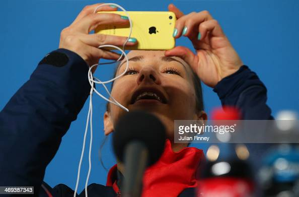 Gold medalist Lizzy Yarnold of Great Britain takes a photograph during a press conference after the Women's Skeleton on Day 7 of the Sochi 2014...