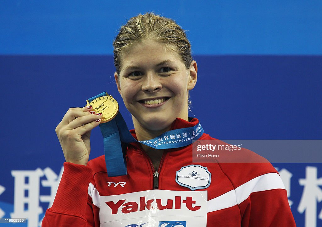 Gold medalist Lotte Friis of Denmark poses with her medal after the Women's 1500m Freestyle Final during Day Eleven of the 14th FINA World...