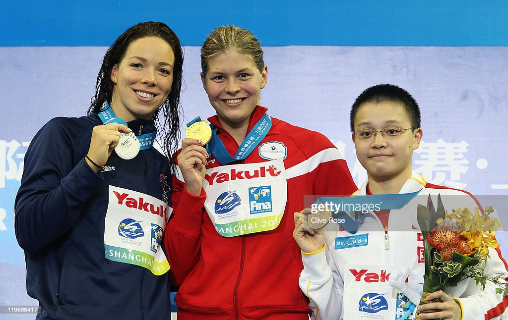 Gold medalist Lotte Friis of Denmark poses with silver medalist Kate Ziegler of United States and bronze medalist Xuanxu Li of China after the...