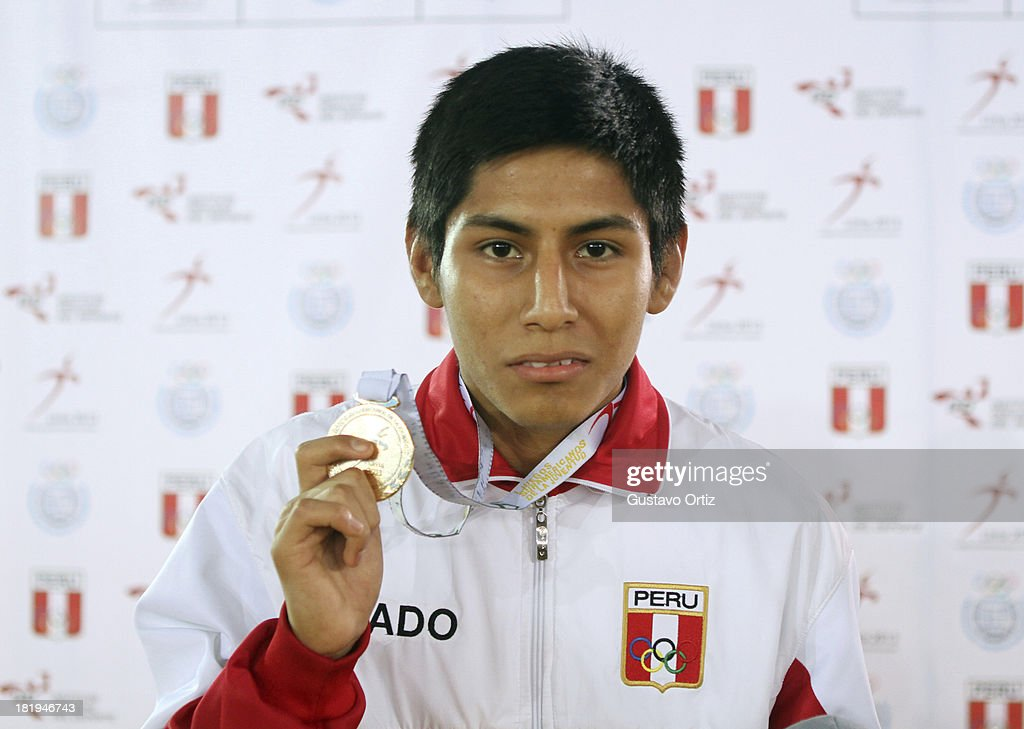 Gold medalist Luis Coronado of Peru in the podium of Greco Roman 50kg as part of the I ODESUR South American Youth Games at Polideportivo Villa Deportiva del Callao on September 26, 2013 in Lima, Peru.