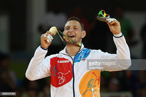 Gold medalist Lukas Krpalek of the Czech Republic celebrates on the podium after the men's 100kg gold medal judo contest against Elmar Gasimov of...