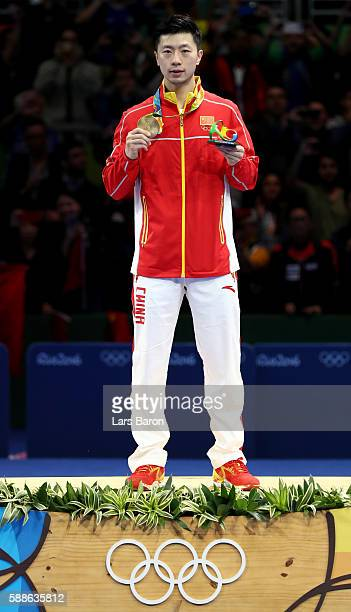 Gold medalist Ma Long of China pose on the podium during the medal ceremony for the Mens Table Tennis Gold Medal match between Ma Long of China and...