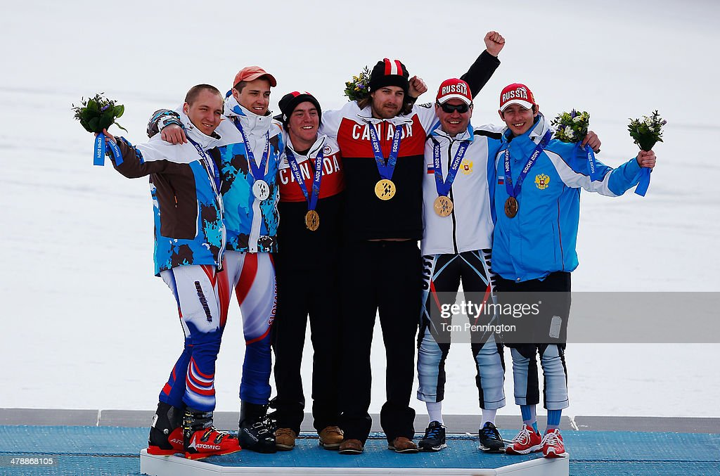 Gold medalist Mac Marcoux (3rdL) of Canada and guide Robin Femy celebrate with silver medalists Jakub Krako (L) of Slovakia and guide Martin Motyka and bronze medalists Valerii Redkozubov of Russia and guide Evgeny Geroev during the medal ceremony for the Men's Giant Slalom Visually Impaired on day eight of the Sochi 2014 Paralympic Winter Games at Rosa Khutor Alpine Center on March 15, 2014 in Sochi, Russia.