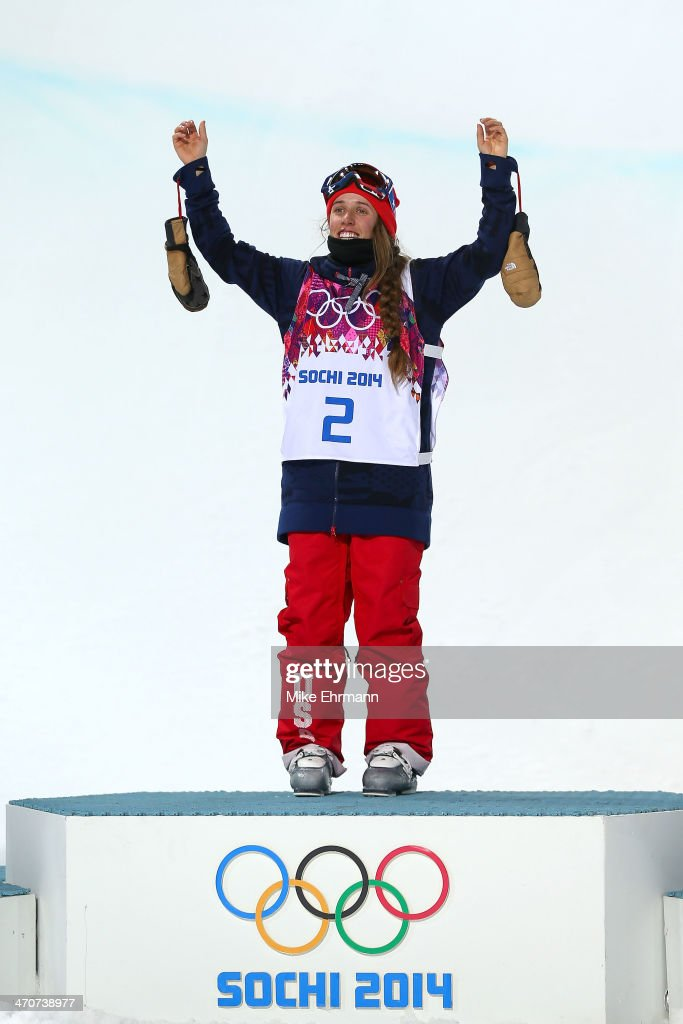 Gold medalist Maddie Bowman of the United States celebrates during the flower ceremony in the Freestyle Skiing Ladies' Ski Halfpipe Finals on day thirteen of the 2014 Winter Olympics at Rosa Khutor Extreme Park on February 20, 2014 in Sochi, Russia.