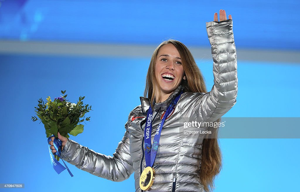 Gold medalist <a gi-track='captionPersonalityLinkClicked' href=/galleries/search?phrase=Maddie+Bowman&family=editorial&specificpeople=8052656 ng-click='$event.stopPropagation()'>Maddie Bowman</a> of the United States celebrates during the medal ceremony for the Women's Ski Halfpipe on day fourteen of the Sochi 2014 Winter Olympics at Medals Plaza on February 21, 2014 in Sochi, Russia.