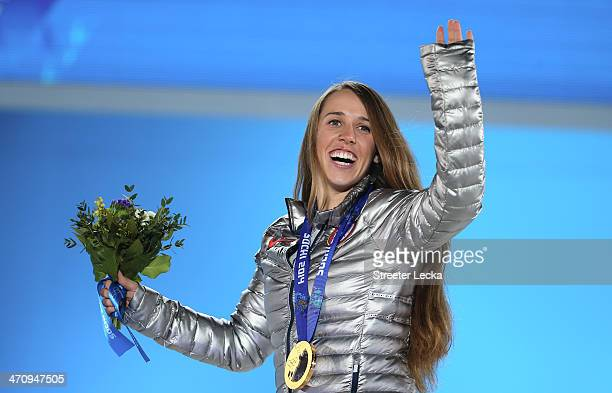 Gold medalist Maddie Bowman of the United States celebrates during the medal ceremony for the Women's Ski Halfpipe on day fourteen of the Sochi 2014...