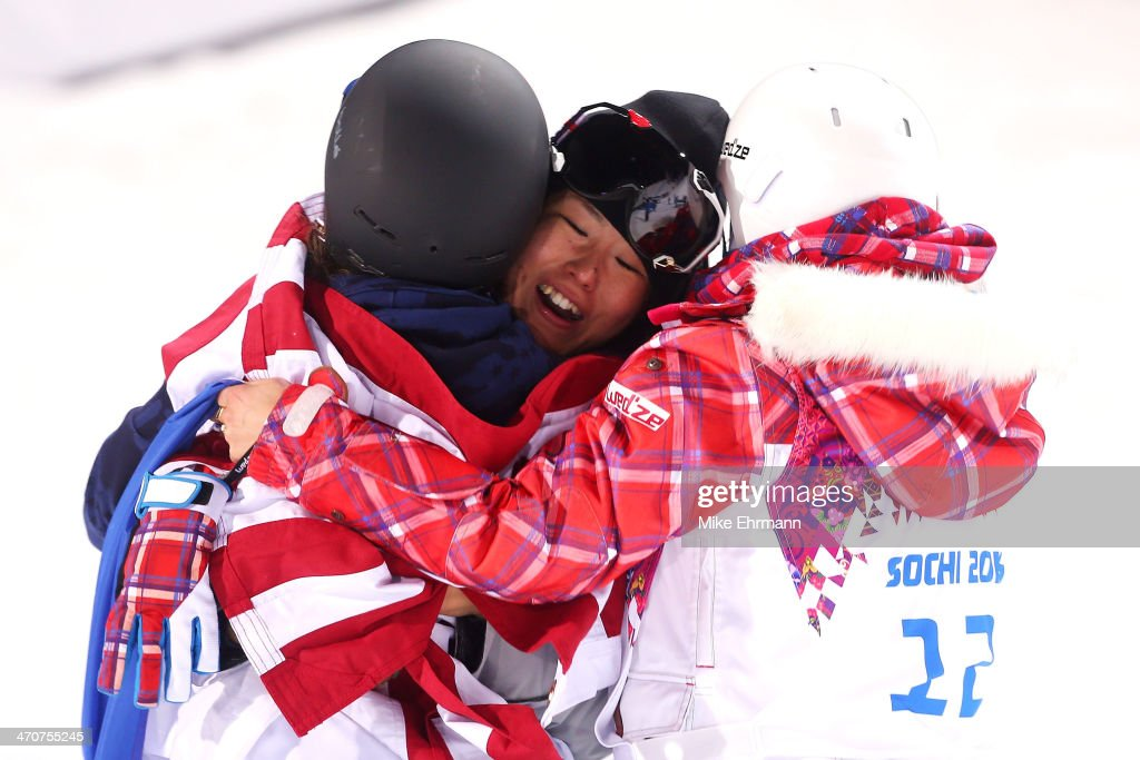 Gold medalist Maddie Bowman (L) of the United States hugs bronze medalist Ayana Onozuka (C) of Japan with silver medalist Marie Martinod (R) of France in the Freestyle Skiing Ladies' Ski Halfpipe Finals on day thirteen of the 2014 Winter Olympics at Rosa Khutor Extreme Park on February 20, 2014 in Sochi, Russia.